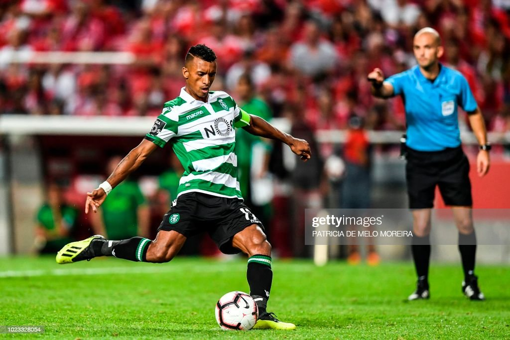 Sporting's forward Nani shoots a penalty kick to score a goal during the Portuguese league football match between SL Benfica and Sporting CP at the Luz stadium in Lisbon on August 25, 2018.