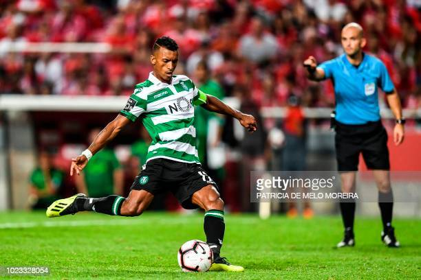 Sporting's forward Nani shoots a penalty kick to score a goal during the Portuguese league football match between SL Benfica and Sporting CP at the...