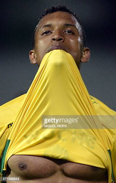 Sporting's forward Nani stretches his jersey with the mouth during the Portuguese league football match Moreirense FC vs Sporting CP at the...