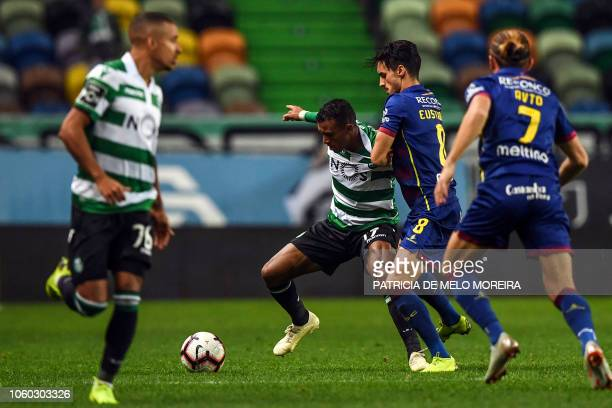 Sporting's forward Nani vies with Chaves' midfielder Stephen Eustaquio during the Portuguese league football match between Sporting CP and GD Chaves...