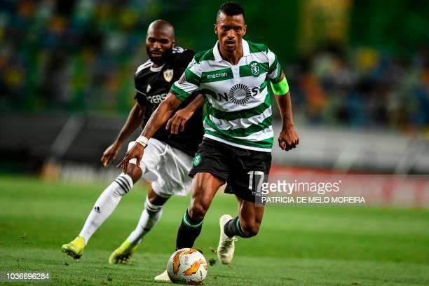 Sporting's forward Nani vies with Qarabag's Swiss forward Innocent Emeghara during the UEFA Europa League group E football match between Sporting CP...