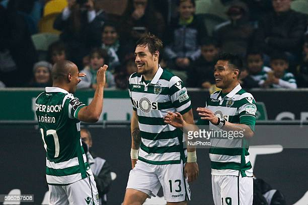 Sporting's forward Teofilo Gutierrez celebrates his goal with Sporting's defender Sebastian Coates and Sporting's midfielder Joao Mario during the...