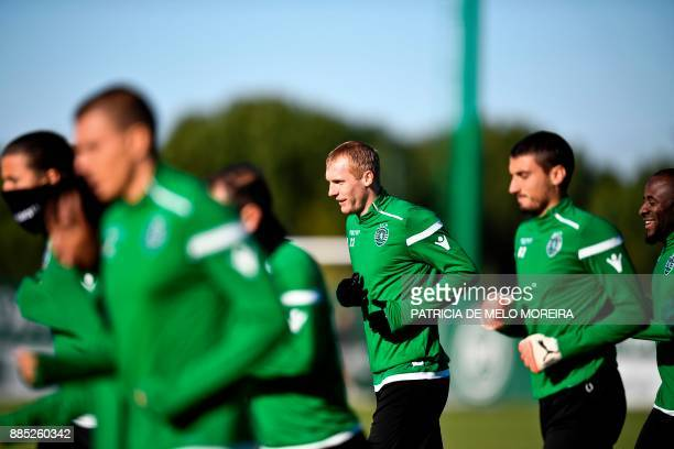 Sporting's French defender Jeremy Mathieu attends a training session at Sporting's training ground in Alcochete, outskirts of Lisbon, on December 4...