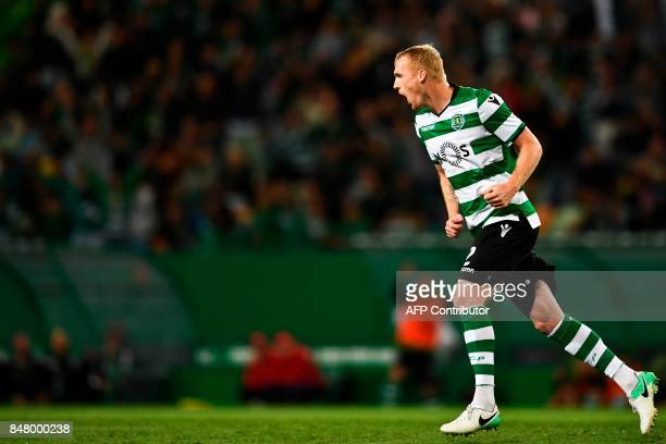 Sporting's French defender Jeremy Mathieu celebrates after scoring during the Portuguese league football match Sporting CP vs CD Tondela at the Jose...
