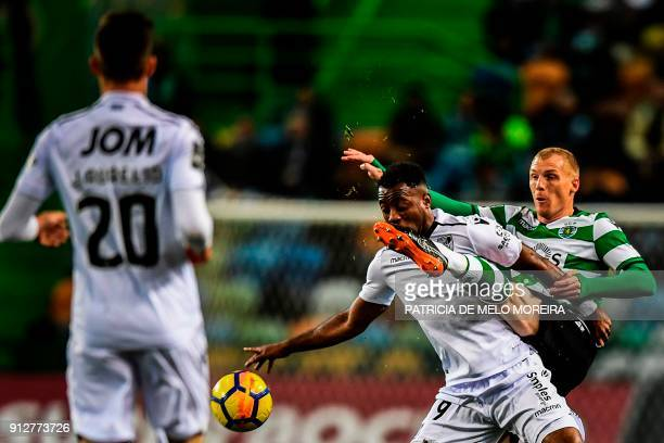 TOPSHOT Sporting's French defender Jeremy Mathieu vies with Guimaraes' Ivorian forward Tallo Junior during the Portuguese League football match...