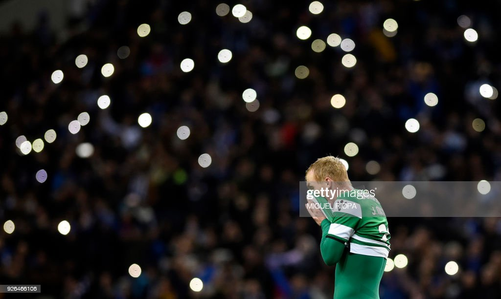 Sporting's French defender Jeremy Mathieu wipes his face at the end of the Portuguese league football match FC Porto against Sporting CP at the Dragao stadium in Porto on March 02, 2018. /