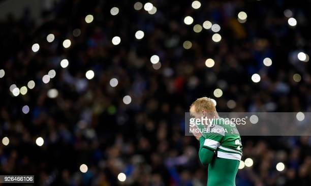 Sporting's French defender Jeremy Mathieu wipes his face at the end of the Portuguese league football match FC Porto against Sporting CP at the...
