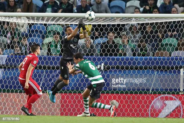 Sporting's goalkeeper Rui Patricio from Portugal makes a safe during the UEFA Champions League group D football match Sporting CP vs Olympiacos FC at...
