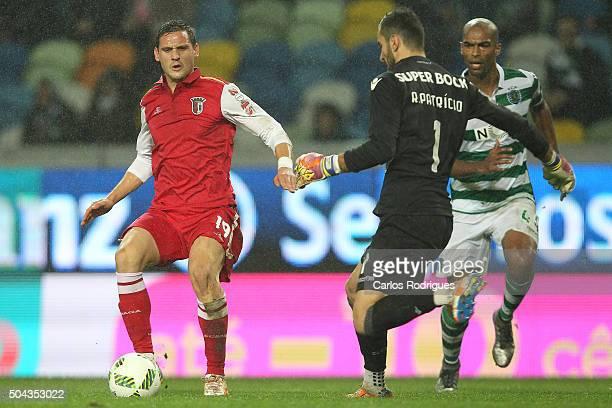 Sporting's goalkeeper Rui Patricio stops Braga's midfielder Nikola Stojiljkovic during the match between Sporting CP and SC Braga for the Portuguese...