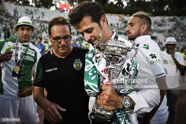 Sporting's head coach Marco Silva holds the trophy as he celebrates the victory at the end of the Taca de Portugal football match final Sporting CP...