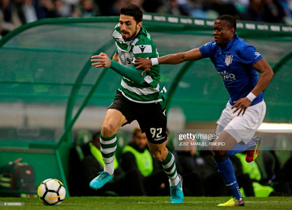 Sportings Italian defender Cristiano Piccini (L)) vies with Feirenses Ugandas defender Alex Kakuba during the Portuguese league football match between Sporting CP and CD Feirense at the Jose Alvalade stadium in Lisbon on February 11, 2018. /