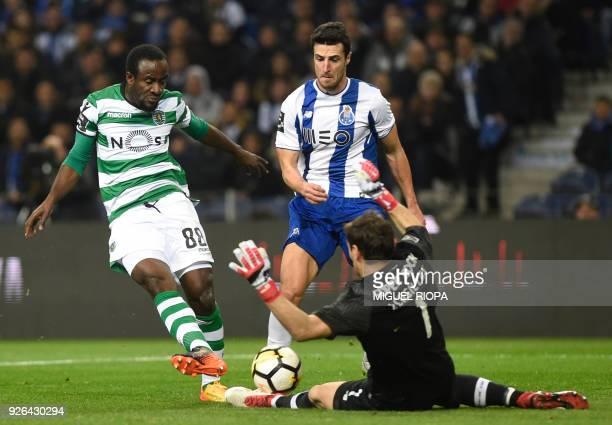 Sporting's Ivorian forward Seydou Doumbia vies with Porto's Spanish goalkeeper Iker Casillas beside Porto's Spanish defender Ivan Marcano during the...
