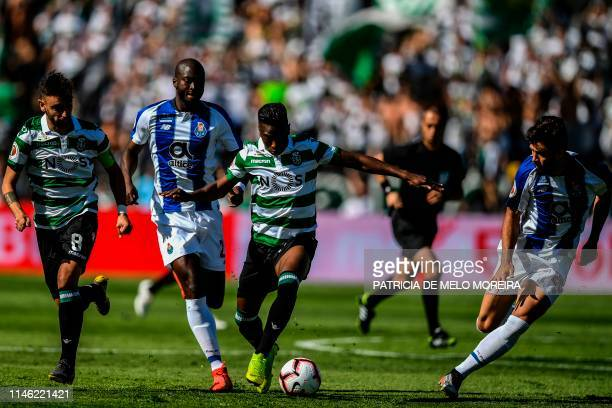 Sporting's Malayan forward Abdoulay Diaby challenges Porto's Portuguese midfielder Danilo Pereira during the Portugal's Cup final football match...