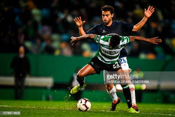Sporting's Malayan forward Abdoulay Diaby vies with Belenenses' Portuguese midfielder Andre Santos during the Portuguese League football match...