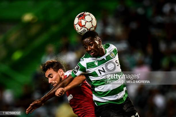 Sporting's Malian forward Abdoulay Diaby heads the ball with Braga's Portuguese midfielder Andre Horta during the Portuguese League football match...