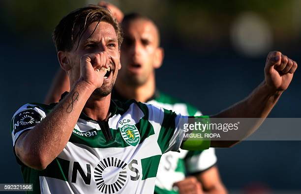 Sporting's midfielder Adrien Silva celebrates after scoring a goal during the Portuguese league football match FC Pacos de Ferreira vs Sporting CP at...