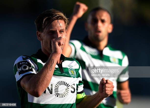 Sporting's midfielder Adrien Silva celebrates after scoring during the Portuguese league football match FC Pacos de Ferreira vs Sporting CP at the...