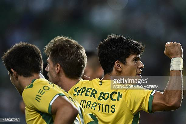 Sporting's midfielder Adrien Silva celebrates with his teammate Sporting's midfielder Andre Martins after scoring during the Violinos Cup football...