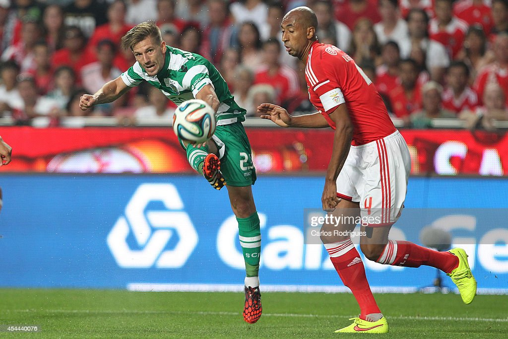 Sporting's midfielder Adrien Silva kicks for the goal during the Primeira Liga match between SL Benfica and Sporting CP at Estadio da Luz on August 31, 2014 in Lisbon, Portugal. (Photo by Carlos Rodrigues/Getty Images).