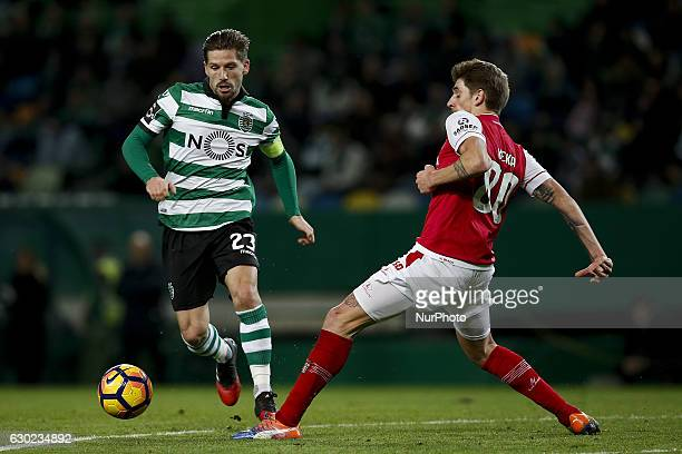 Sporting's midfielder Adrien Silva vies for the ball with Braga's midfielder Xeka during Premier League 2016/17 match between Sporting CP vs Vitoria...