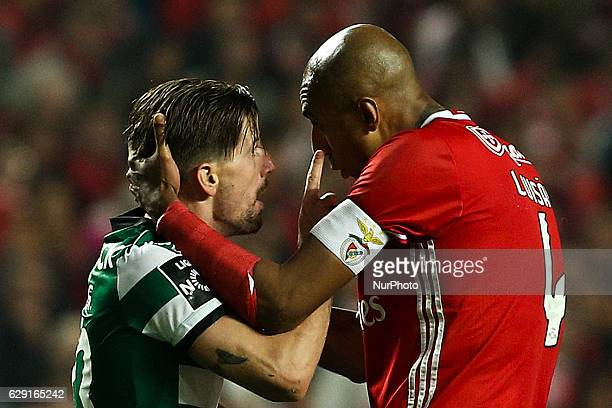 Sporting's midfielder Adrien Silva vies with Benfica's Brazilian defender Luis Da silva 'Luisao' during the Portuguese League football match between...