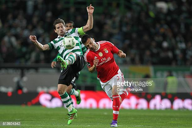 Sporting's midfielder Adrien Silva vies with Benfica's midfielder Andreas Samaris during the match between Sporting CP and SL Benfica for the...