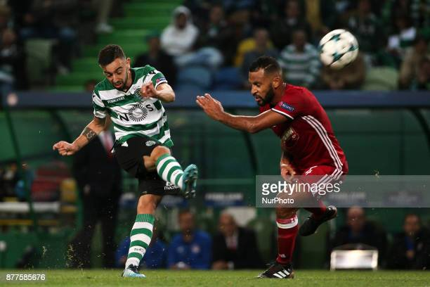 Sportings midfielder Bruno Fernandes and Olympiakos Piraeus midfielder Alaixys Romao during the UEFA Champions League group D match between Sporting...