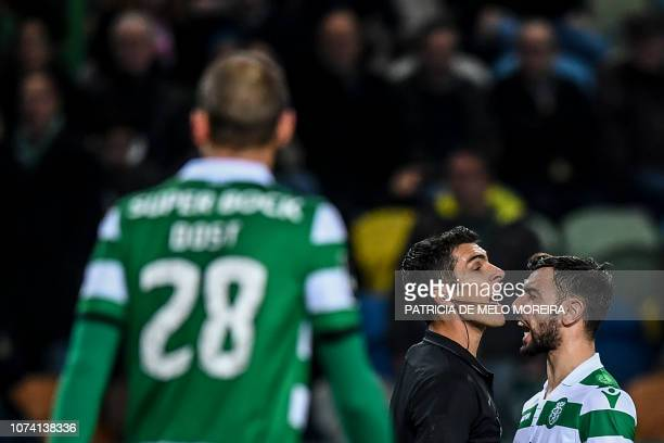 Sporting's midfielder Bruno Fernandes argues with Portuguese referee Fabio Verissimo during the Portuguese League football match between Sporting...