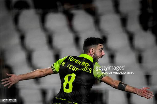 Sporting's midfielder Bruno Fernandes celebrates a goal during the Portuguese league football match between Vitoria FC and Sporting CP at the Bonfim...