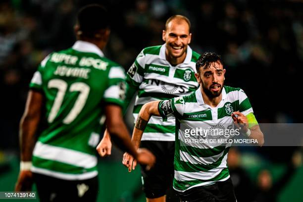 Sporting's midfielder Bruno Fernandes celebrates a goal with teammates Dutch forward Bas Dost and Cape Verdean Jovane Cabral during the Portuguese...