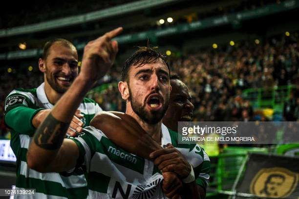 Sporting's midfielder Bruno Fernandes celebrates a goal with teammates during the Portuguese League football match between Sporting Lisbon and...