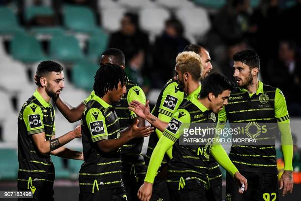 Sporting's midfielder Bruno Fernandes celebrates a goal with teammates during the Portuguese league football match between Vitoria FC and Sporting CP...