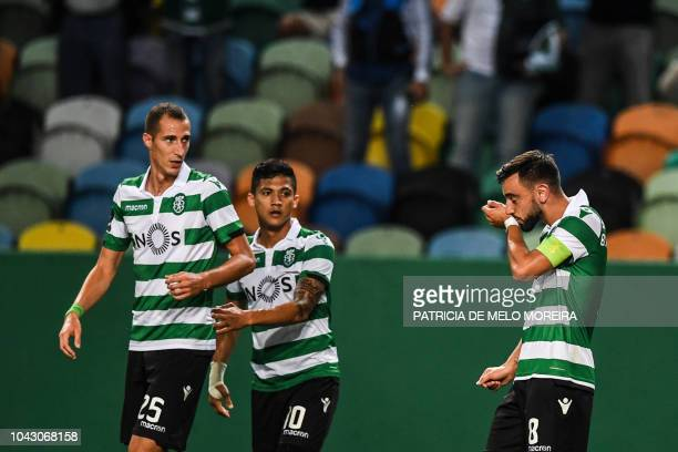 Sporting's midfielder Bruno Fernandes celebrates with his teammates after scoring a goal during the Portuguese league footbal match between Sporting...