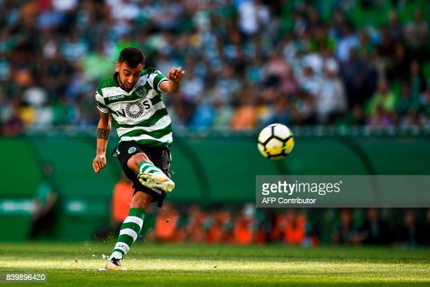 Sporting's midfielder Bruno Fernandes kicks the ball to score during the Portuguese league football match Sporting CP vs Estoril Praia at the Jose...