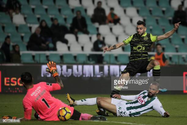 Sporting's midfielder Bruno Fernandes scores a goal next to Setubal's defender Pedro Pinto and Setubal's goalkeeper Cristiano Pereira during the...