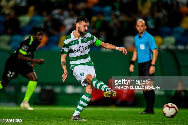 Sporting's midfielder Bruno Fernandes shoots a penalty kick to score a goal during the Portuguese league football match between Sporting CP and Rio...