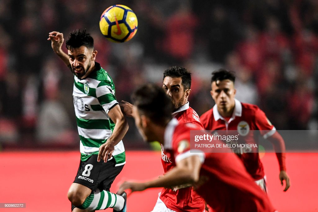 Sporting's midfielder Bruno Fernandes (L) vies with Benfica's Brazilian defender Jardel (2R) during the Portuguese league football match SL Benfica vs Sporting CP at the Luz stadium in Lisbon on January 3, 2018. /