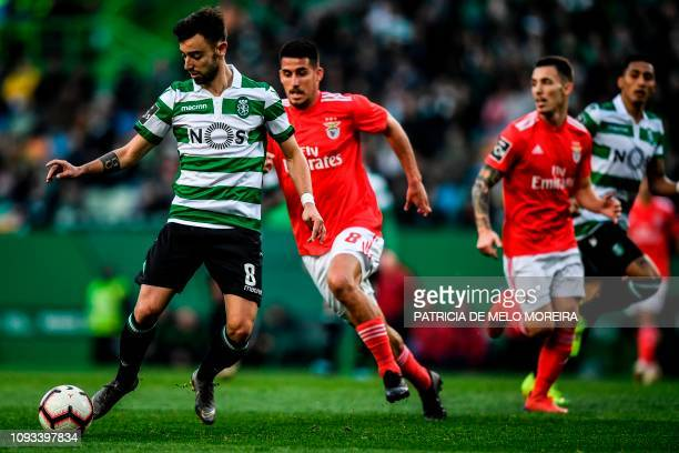 Sporting's midfielder Bruno Fernandes vies with Benfica's Spanish midfielder Gabriel Appelt during the Portuguese League football match between...