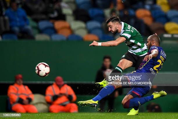 Sporting's midfielder Bruno Fernandes vies with Chaves' Brazilian defender Marcao Teixeira during the Portuguese league football match between...