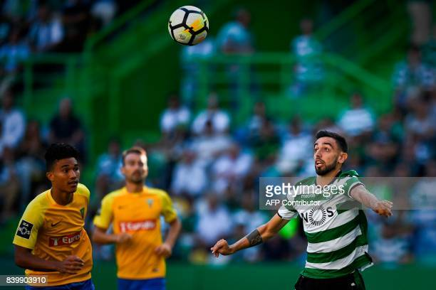 Sporting's midfielder Bruno Fernandes vies with Estoril's Brazilian forward Gustavo Tocantins during the Portuguese league football match Sporting CP...