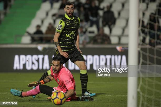 Sporting's midfielder Bruno Fernandes vies with Setubal's goalkeeper Cristiano Pereira during the Portuguese League football match between Vitoria...