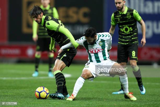 Sporting's midfielder Bryan Ruiz vies with Setubal's Portuguese midfielder Joao Costinha during the Portuguese League Cup 2017/18 Final match between...