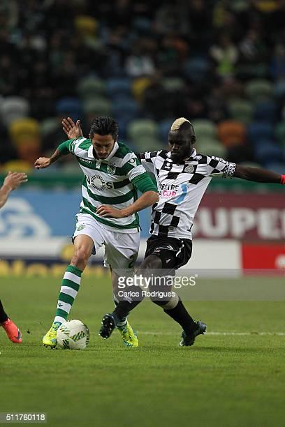 Sporting's midfielder Ezequiel Schelotto tries to escape Boavista's midfielder Idris during the match between Sporting CP and Boavista FC for the...