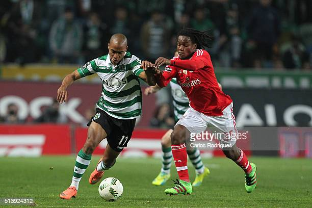 Sporting's midfielder Joao Mario vies with Benfica's midfielder Renato Sanches during the match between Sporting CP and SL Benfica for the Portuguese...