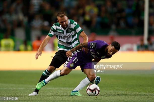 Sporting's midfielder Josip Misic vies for the ball with Setubal's forward Joao Costa during Primeira Liga 2018/19 match between Sporting CP vs...