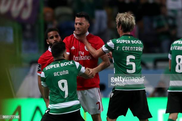 Sporting's midfielder Marcos Acuna from Argentina and Sporting's defender Fabio Coentrao from Portugal argue with Benfica's Brazilian defender...