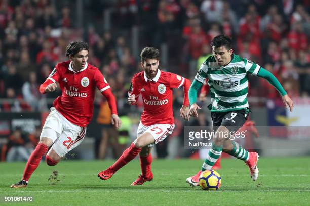 Sporting's midfielder Marcos Acuna from Argentina vies with Benfica's Croatian forward Filip Krovinovic and Benfica's Portuguese midfielder Rafa...