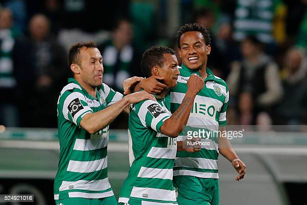 Sporting's midfielder Nani celebrates his goal with Sporting's defender Jefferson and Sporting's forward Andre Carrillo during the Portuguese League...