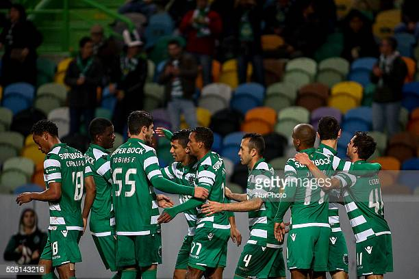 Sporting's midfielder Nani celebrates with team mates after scoring during the Portuguese League football match between Sporting CP and Rio Ave FC at...