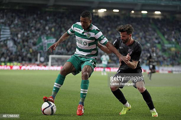 Sporting's midfielder Nani vies with Guimaraes's midfielder Alex during the Primeira Liga Portugal match between Sporting CP and Vitoria Guimaraes at...